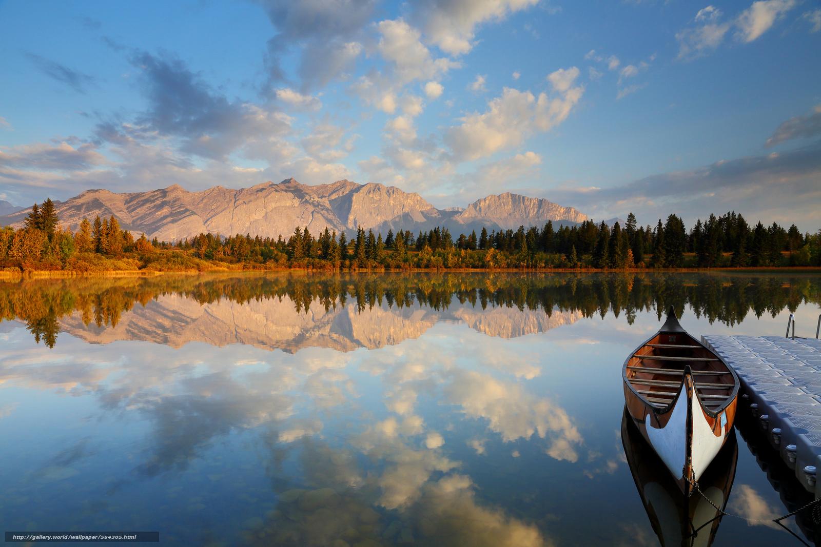 человек в лодке река горы
