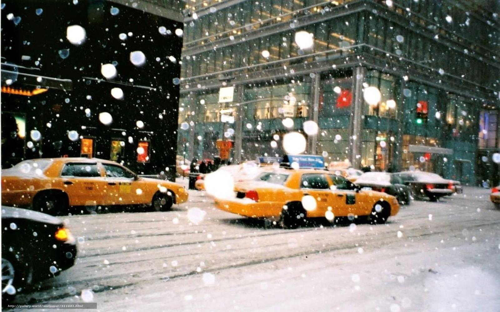 download wallpaper yellow taxi in a new york snow free