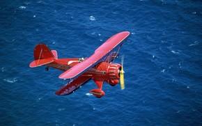 Авиация: биплан, красный, море